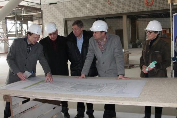 Xavier Bettel, François Bausch et Guy Arendt ont visité le chantier de la nouvelle Bibliothèque nationale. (Photo: ministère de la Culture)