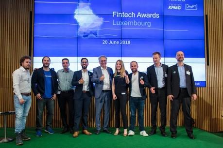 Les huit finalistes entourent le ministre des Finances, Pierre Gramegna. (Photo: Matic Zorman)